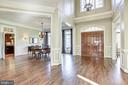 Foyer view into the dining room - 40989 GRENATA PRESERVE PL, LEESBURG
