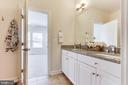 ... sports a large double vanity and... - 3160 VIRGINIA BLUEBELL CT, FAIRFAX