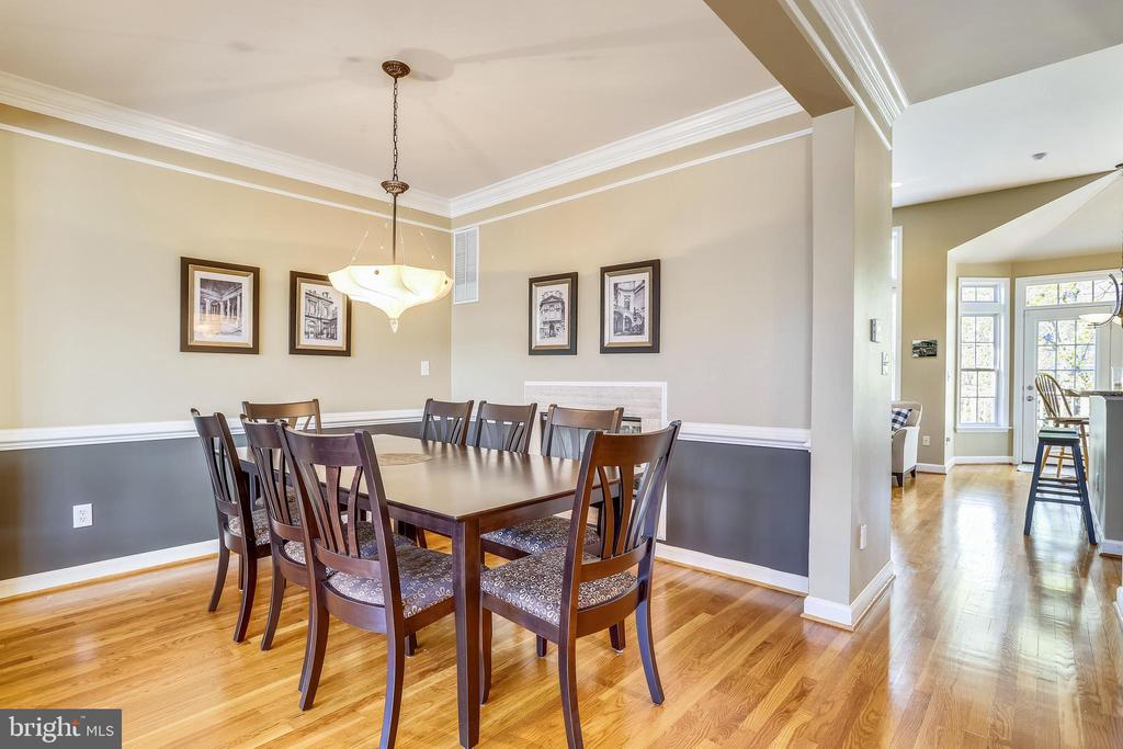 Dining Room shares the Two-Sided Fireplace - 1911 LOGAN MANOR DR, RESTON