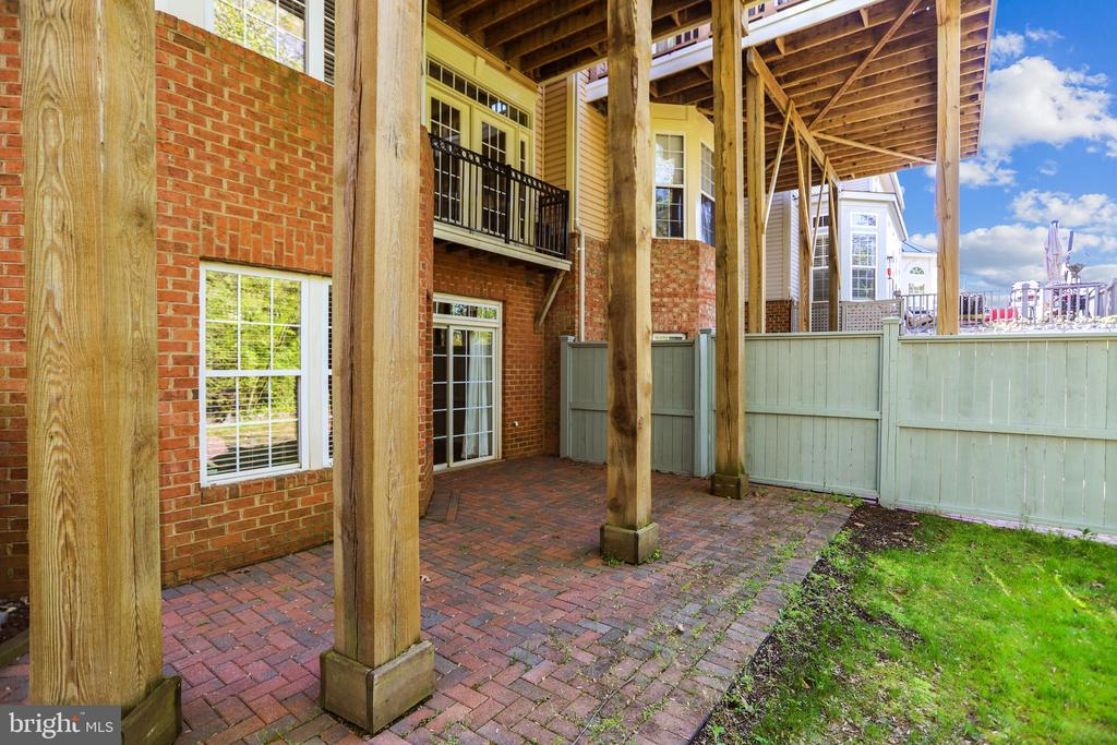 Walkout access to rear yard and Brick Patio - 1911 LOGAN MANOR DR, RESTON
