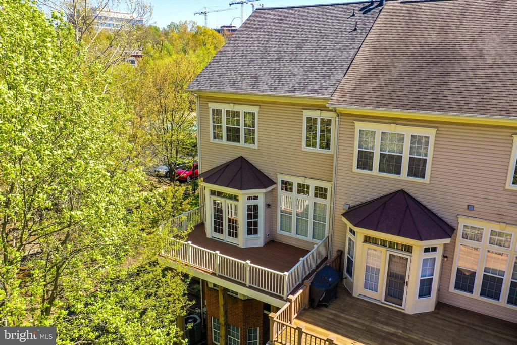 Your large Rear Deck nestled in the trees! - 1911 LOGAN MANOR DR, RESTON