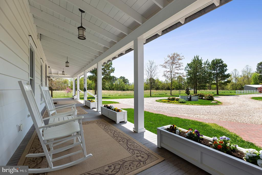 The deep porch is perfect for rocking chairs - 15270 HATTON LANDING DR, NEWBURG