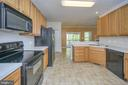 Oodles of counter and cabinet space - 412 BIRDIE RD, LOCUST GROVE