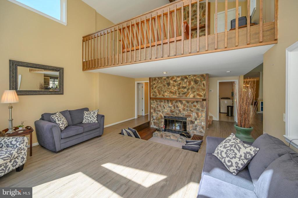 Loft overlooks conversation pit with fireplace - 118 CONFEDERATE CIR, LOCUST GROVE
