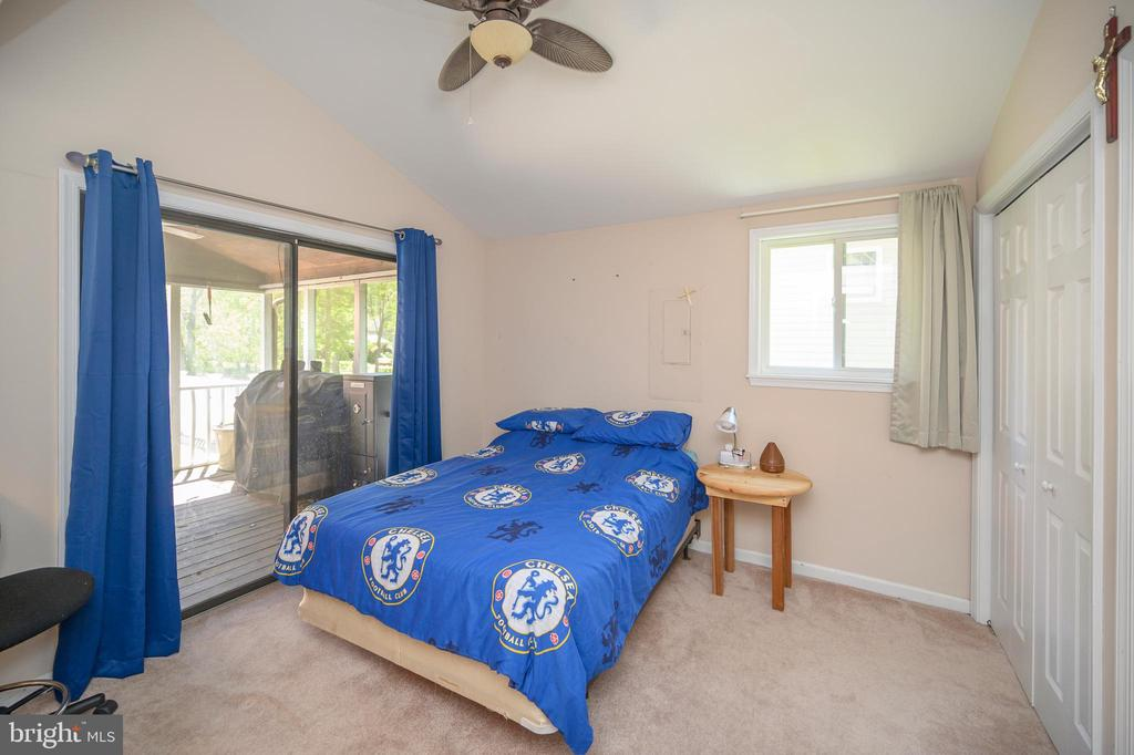 Main level bedroom 2 with access to screened porch - 118 CONFEDERATE CIR, LOCUST GROVE