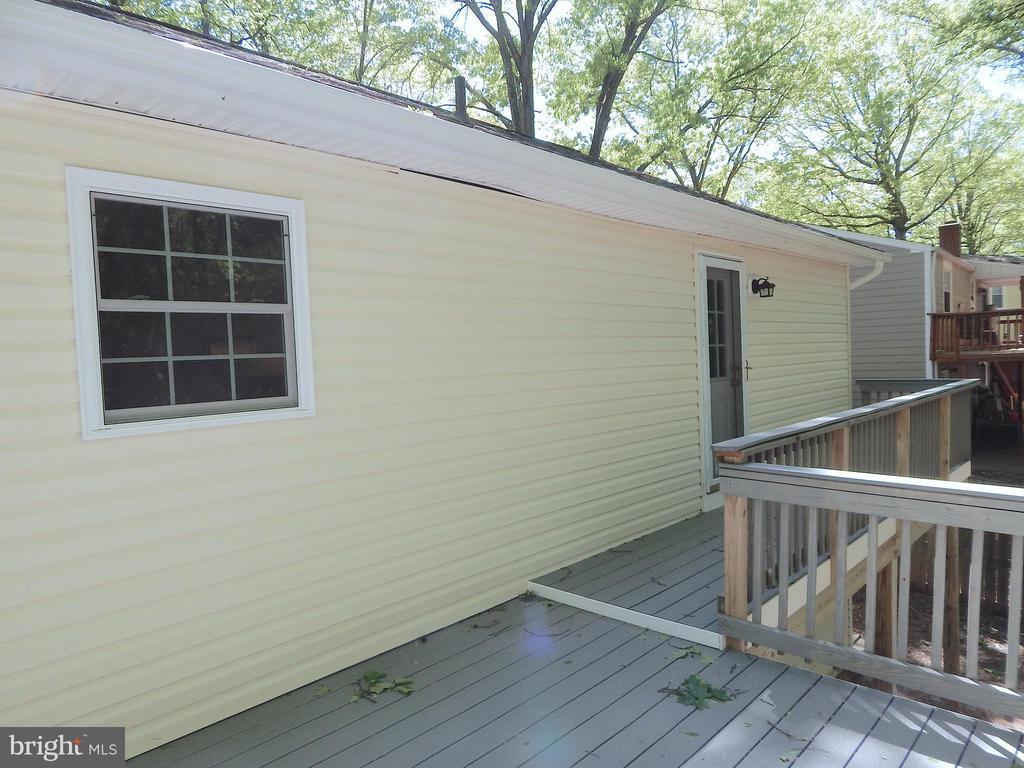 Rear composite deck showing door to master bedroom - 4 NORMAN CT, FREDERICKSBURG