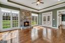 Sunroom with wood fireplace - 24020 LACEYS TAVERN CT, ALDIE