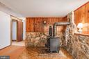 Lower Level Rec Area with Wood Stove - 14720 COURAGE DR, WOODBRIDGE