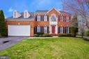Brick Front with elegant grand foyer. - 17720 CRICKET HILL DR, GERMANTOWN