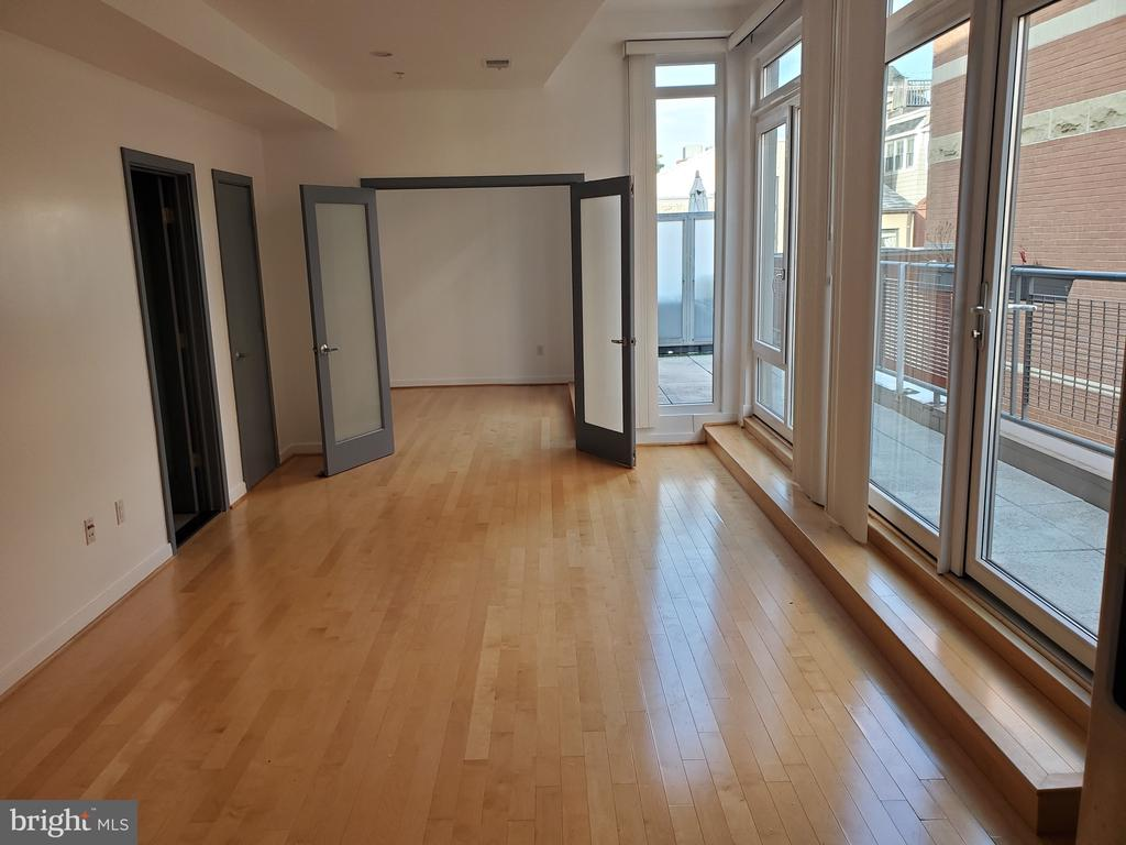 Open Contemporary Floor Plan leads to bedroom. - 1466 NW HARVARD ST NW #PH-3, WASHINGTON