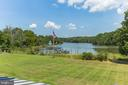 The lawn leads to 2600+ ft of shoreline - 15270 HATTON LANDING DR, NEWBURG