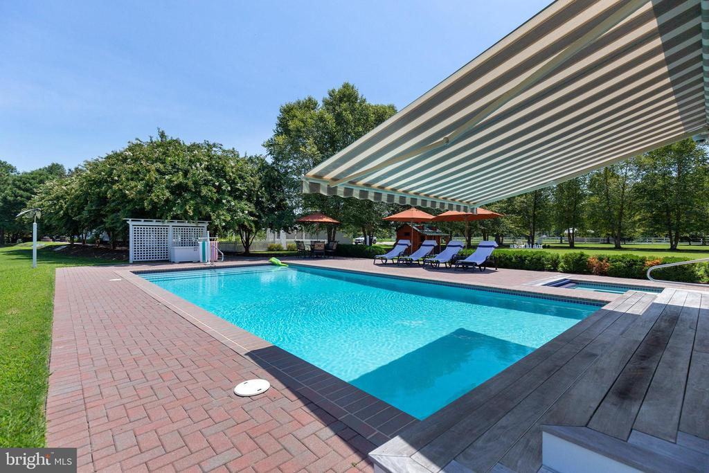 A remote-control canopy provides shade to the pool - 15270 HATTON LANDING DR, NEWBURG