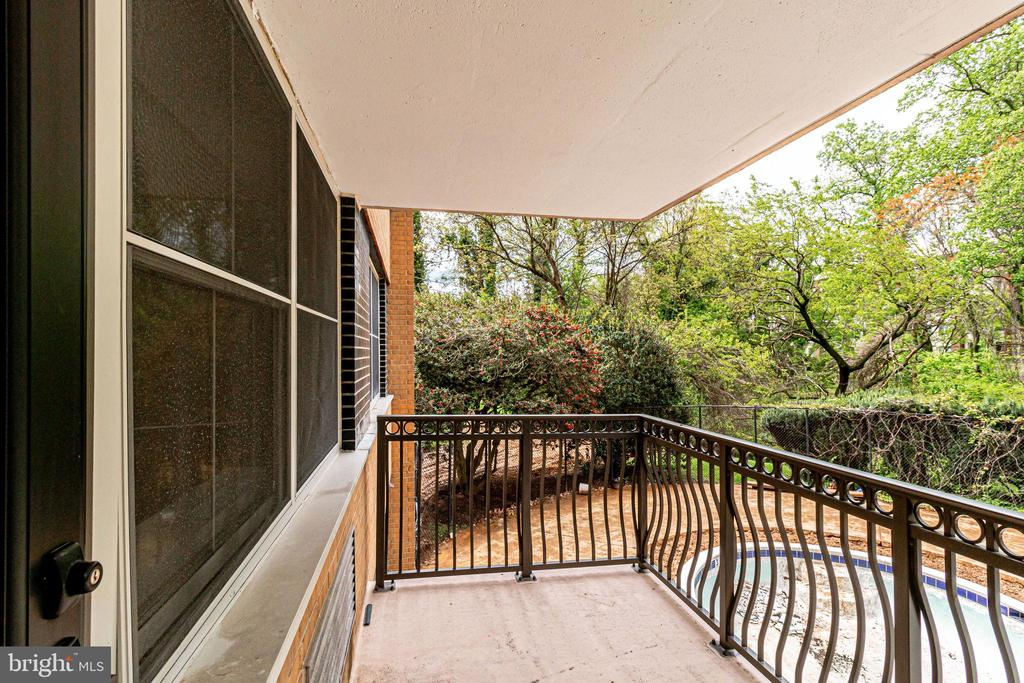 Private balcony overlooking the community pool - 2030 N ADAMS ST #208, ARLINGTON