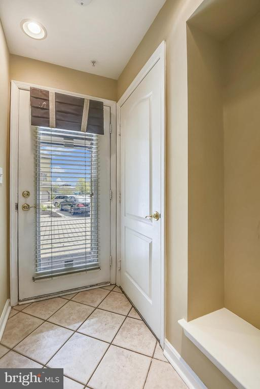Foyer with ceramic tile and heater. - 7016 CLINTON CT #22A, ANNAPOLIS