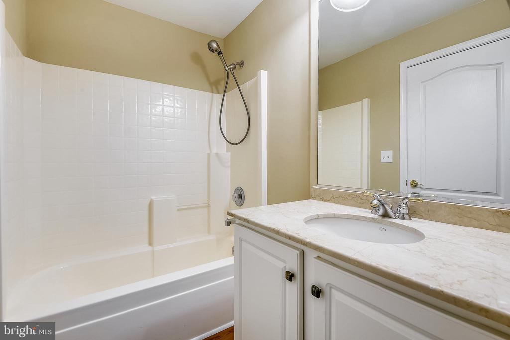 Full bath on upper level with new flooring. - 7016 CLINTON CT #22A, ANNAPOLIS