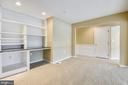 Custom built in shelving and desk with new carpet. - 7016 CLINTON CT #22A, ANNAPOLIS