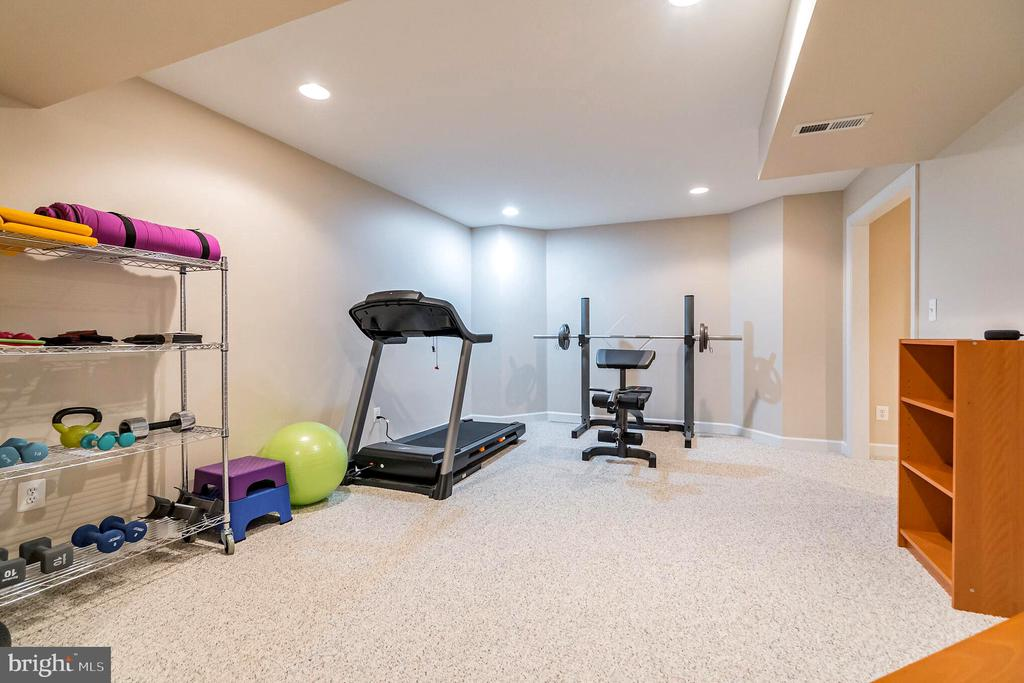 Lower level room awaiting your exercise equipment - 20 WINDSONG WAY, STAFFORD