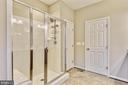 Bright shower with a linen closet in master bath - 17966 WOODS VIEW DR, DUMFRIES