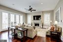 gas fireplace with limestone hearth and surround - 6537 36TH ST N, ARLINGTON