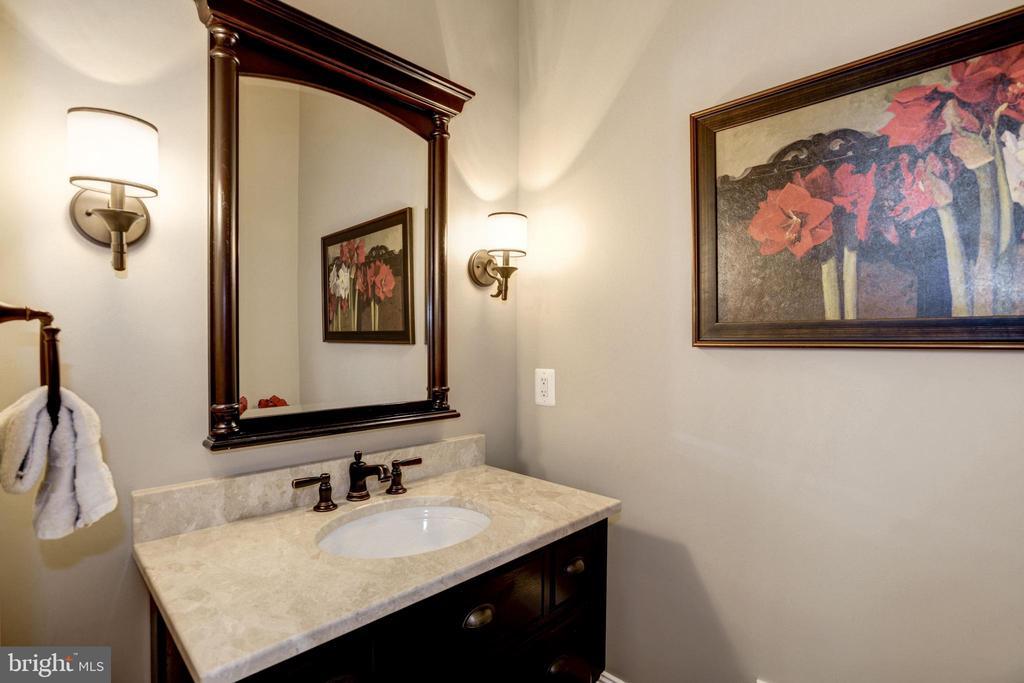 wall sconces in powder room add polish - 6537 36TH ST N, ARLINGTON