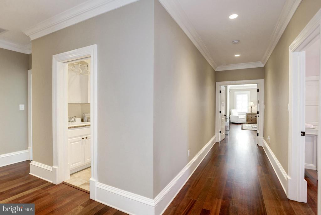 wood floors gleam in upper hall at second laundry - 6537 36TH ST N, ARLINGTON