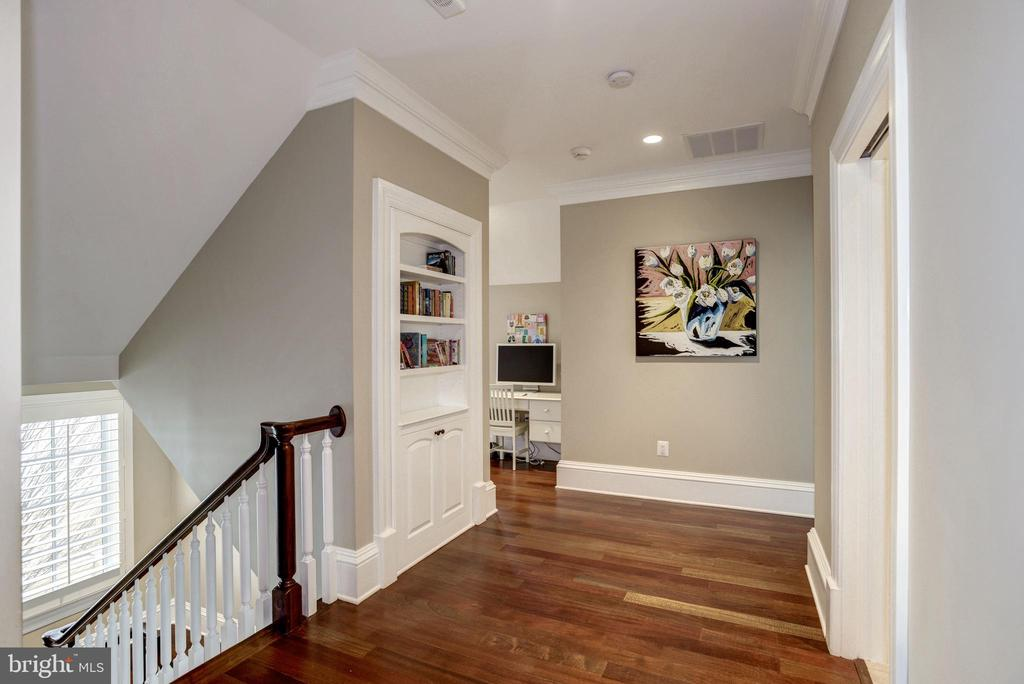 bookcase in the upper hall opens to reveal... - 6537 36TH ST N, ARLINGTON