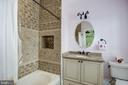 tile in tub surround extends to ceiling, niches - 6537 36TH ST N, ARLINGTON