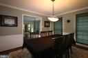 Dining room through entrance hall to living room - 10651 OAKTON RIDGE CT, OAKTON