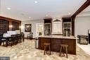 LL rec room bar, built-in wine racks, tile floor - 6537 36TH ST N, ARLINGTON