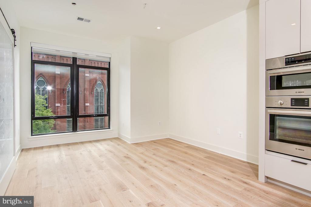 Open living/dining space with larger windows - 801 N NW #303, WASHINGTON
