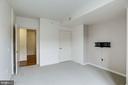 Second bedroom. TV mount conveys. - 1021 N GARFIELD ST #409, ARLINGTON