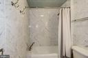 Upgraded tub/shower with second hand shower. - 1021 N GARFIELD ST #409, ARLINGTON
