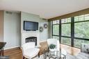 Floor to ceiling windows in the living room. - 1021 N GARFIELD ST #409, ARLINGTON