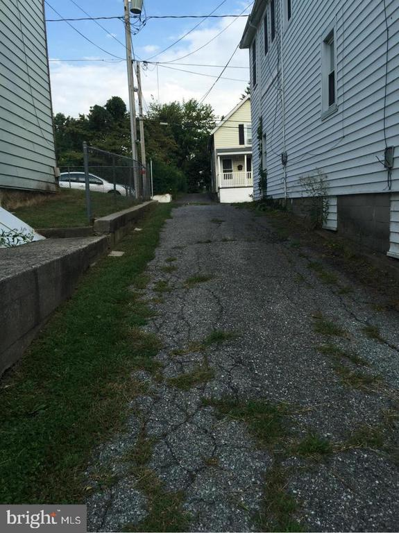 Alley Drive to Parking Spaces - 411 N MAPLE AVE, BRUNSWICK