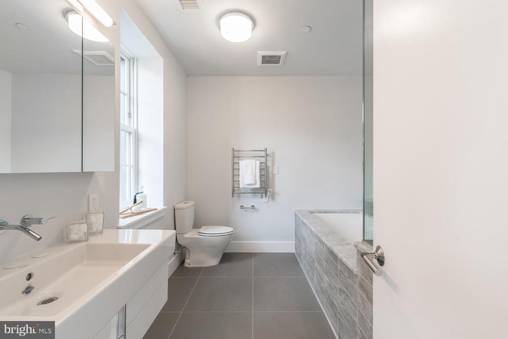 Master bathroom with soaking tub and spa shower - 2709 N ST NW #103, WASHINGTON