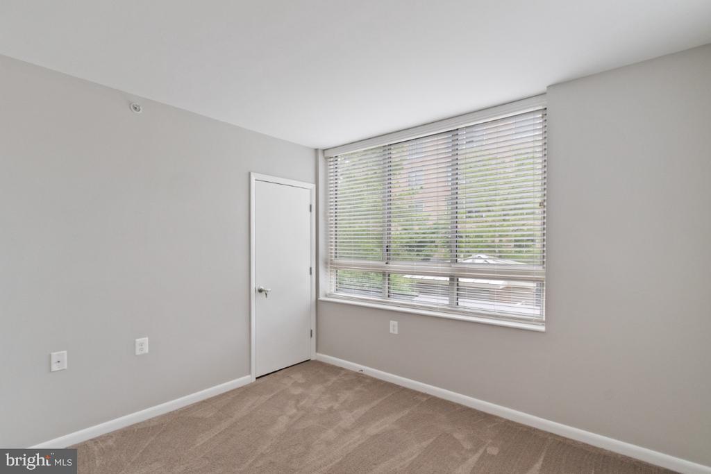 Master bedroom looks over pool area - 350 G ST SW #N224, WASHINGTON