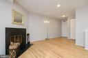 Living Room with Wood Buring Fireplace - 12209 PEACH CREST DR #903-F, GERMANTOWN