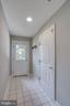 Back door to outside or to garage with tiled floor - 43771 APACHE WELLS TER, LEESBURG