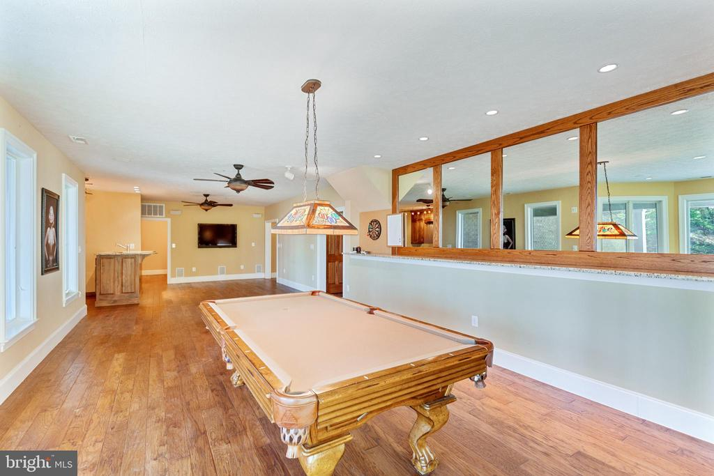 Pool, TV and access to the outdoor patio - 825 CAMP CONOY RD, LUSBY