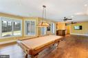 Large windows capture natural outdoor light - 825 CAMP CONOY RD, LUSBY