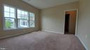 Second level  bedroom with private full bath - 18805 PIER TRAIL DR, TRIANGLE