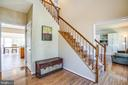 Two-story foyer, hardwood floors, and wood stairs - 6 CROMWELL CT, STAFFORD
