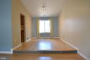 Dining room ~ custom tiled step up & large window - 404 GREEAR PL, HERNDON