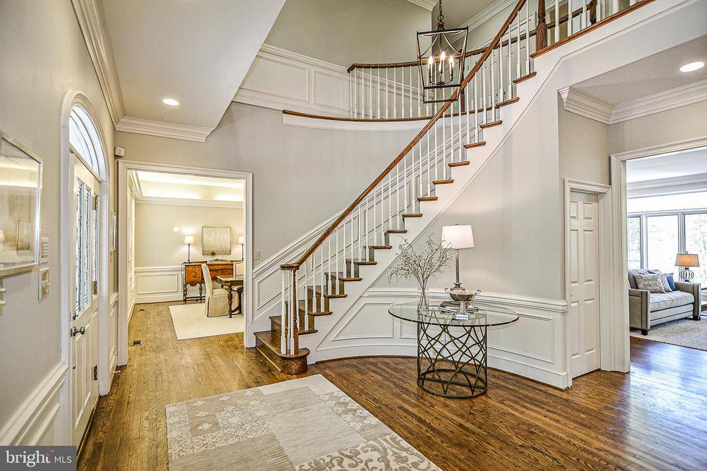 Curved Staircase in Two Story Foyer w/ New Fixture - 12970 WYCKLAND DR, CLIFTON