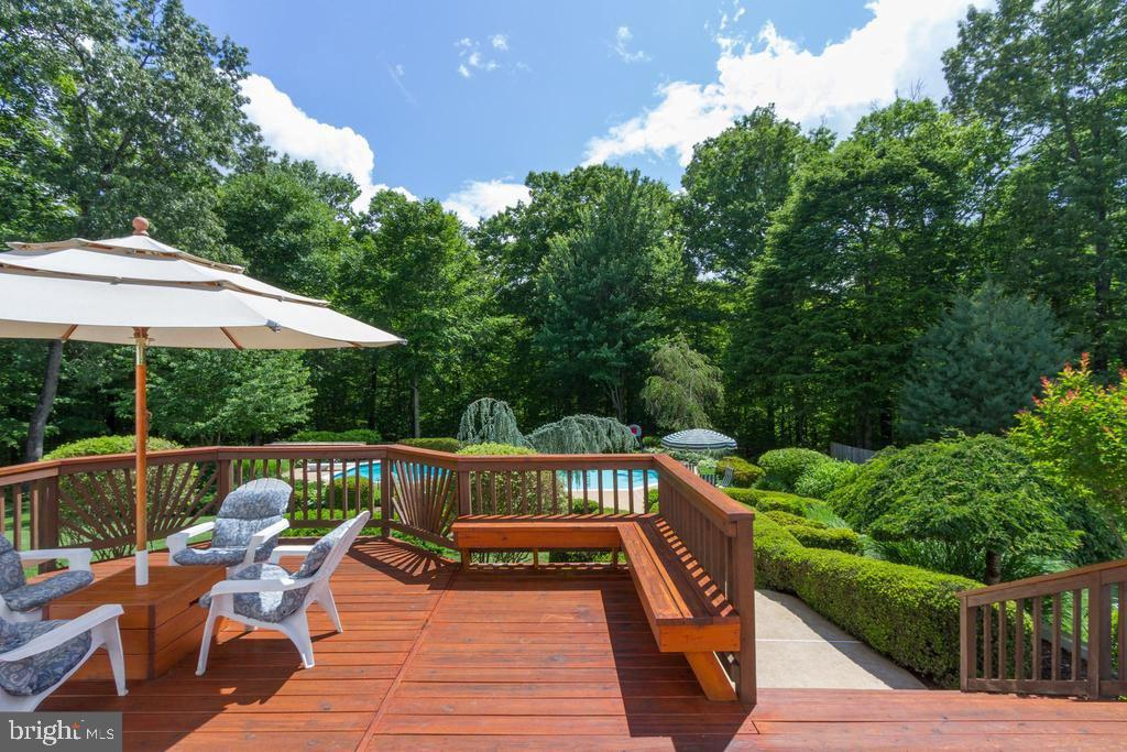 Deck off Breakfast Room with Pool & Woodland Views - 12970 WYCKLAND DR, CLIFTON