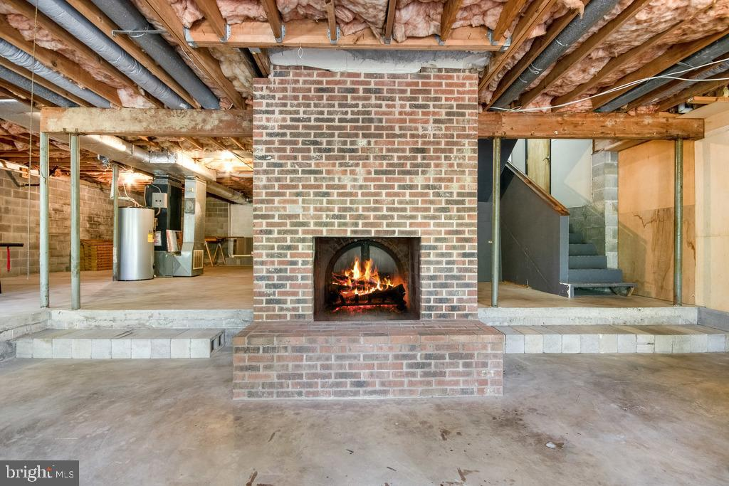 Wood Burning Fireplace in Unfinished Rec Room - 305 VOYAGE CV, STAFFORD