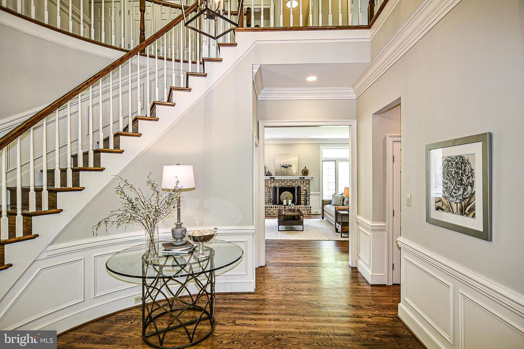 Crown Moldings, Shadow Boxing, Hardwoods in Foyer - 12970 WYCKLAND DR, CLIFTON