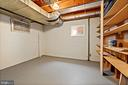 Utility room has additional shelves for storage - 7808 CHARLESTON DR, BETHESDA