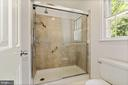 Master bath renovated in neutral colors - 7808 CHARLESTON DR, BETHESDA