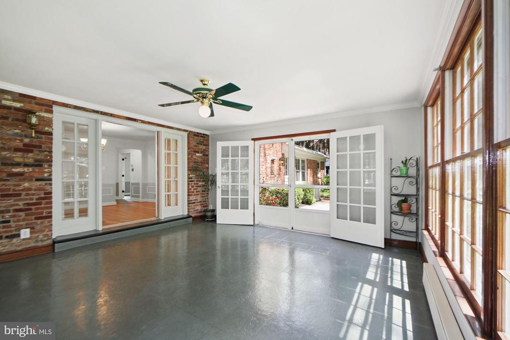Exposed brick wall adds character - 7808 CHARLESTON DR, BETHESDA
